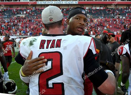 Tampa Bay Buccaneers quarterback Jameis Winston hugs Atlanta Falcons quarterback Matt Ryan (2) after the Falcons defeated the Tampa Bay Buccaneers 34-32 during an NFL football game, in Tampa, Fla