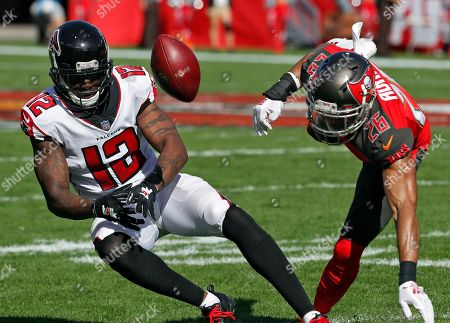 Tampa Bay Buccaneers defensive back Andrew Adams (26) breaks up a pass intended for Atlanta Falcons wide receiver Mohamed Sanu (12) during the first half of an NFL football game, in Tampa, Fla