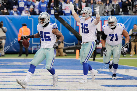 Dallas Cowboys' Rod Smith, left, reacts after scoring a touchdown during the second half of an NFL football game against the New York Giants, in East Rutherford, N.J