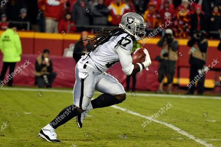 Oakland Raiders wide receiver Dwayne Harris (17) runs with the ball during the second half of an NFL football game against the Kansas City Chiefs in Kansas City, Mo