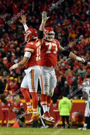Kansas City Chiefs quarterback Patrick Mahomes (15) celebrates with offensive guard Andrew Wylie (77) after his touchdown pass to wide receiver Demarcus Robinson, unseen, during the second half of an NFL football game in Kansas City, Mo., . Mahomes joins Peyton Manning & Tom Brady as the only players with 50+ pass touchdowns in a single season in NFL history