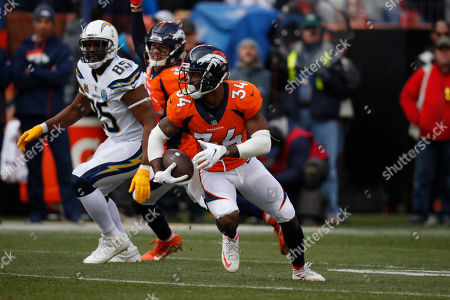 Stock Picture of Denver Broncos strong safety Will Parks (34) intercepts a pass intended for Los Angeles Chargers tight end Antonio Gates (85), during the first half of an NFL football game, in Denver