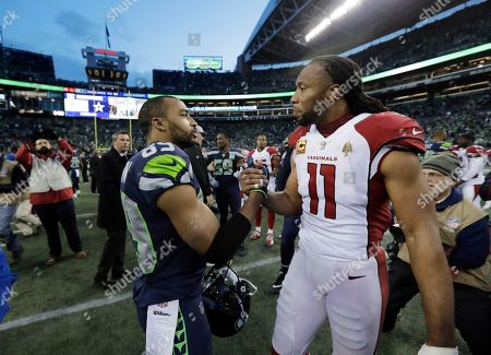 Arizona Cardinals Larry Fitzgerald (11) greets Seattle Seahawks' Doug Baldwin after an NFL football game, in Seattle. The Seahawks won 27-24