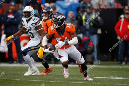 Denver Broncos strong safety Will Parks (34) intercepts a pass intended for Los Angeles Chargers tight end Antonio Gates (85), during the first half of an NFL football game, in Denver