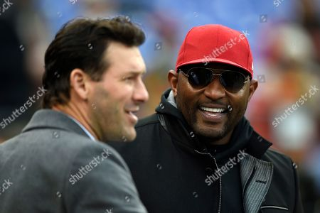 Week 13. Former Baltimore Ravens linebacker Ray Lewis, right, speaks with former Dallas Cowboys quarterback Tony Romo before an NFL football game between the Ravens and the Cleveland Browns, in Baltimore