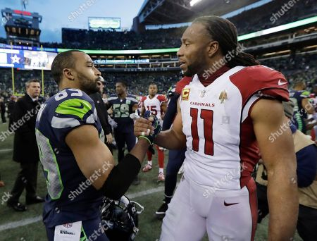 Doug Baldwin, Larry Fitzgerald. Seattle Seahawks' Doug Baldwin, left, greets Arizona Cardinals' Larry Fitzgerald after an NFL football game, in Seattle