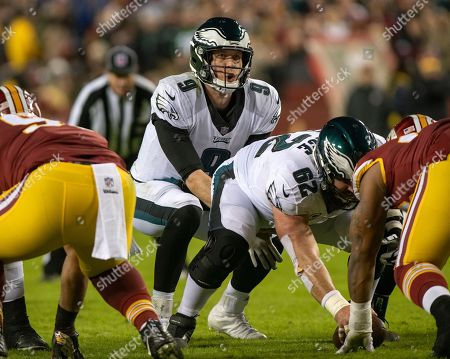 Philadelphia Eagles quarterback Nick Foles (9) calls the signals in second quarter action against the Washington Redskins at FedEx Field in Landover, Maryland. Philadelphia Eagles center Jason Kelce (62) is holding the ball. The Eagles won the game 24 - 0.
