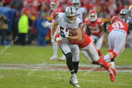 Oakland Raiders wide receiver Jordy Nelson (82) is tackled from behind during the NFL Football Game between the Oakland Raiders and the Kansas City Chiefs at Arrowhead Stadium in Kansas City, Missouri