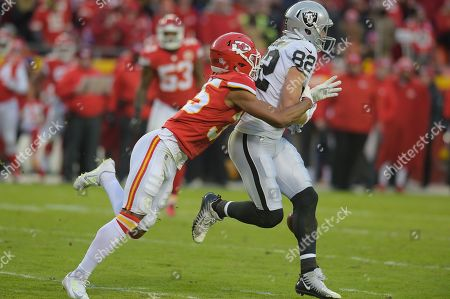 Stock Image of Oakland Raiders wide receiver Jordy Nelson (82) is tackled by Kansas City Chiefs cornerback Charvarius Ward (35) after a reception during the NFL Football Game between the Oakland Raiders and the Kansas City Chiefs at Arrowhead Stadium in Kansas City, Missouri