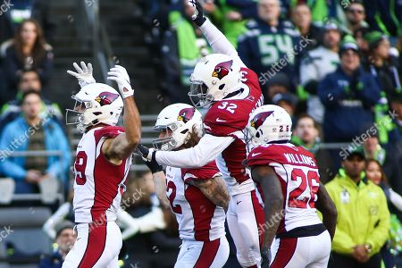 Arizona Cardinals linebacker Joe Walker (59) and the Cardinals celebrate a defensive stop during a game between the Arizona Cardinals and the Seattle Seahawks at CenturyLink Field in Seattle, WA. The Seahawks defeated the Cardinals 27-24
