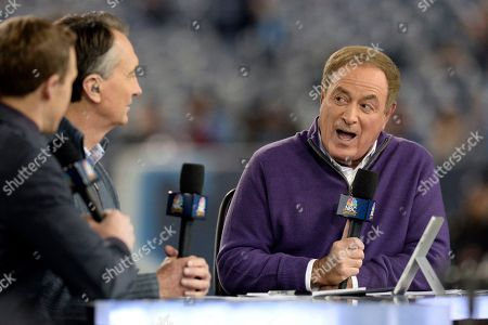 Al Michaels, right, and Cris Collinsworth, second from left, broadcast from the field before an NFL football game between the Tennessee Titans and the Indianapolis Colts, in Nashville, Tenn