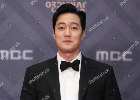 So Ji-sub poses for a photo during the awards ceremony for the 2018 Drama Awards of the public broadcaster MBC in Seoul, South Korea, 30 December 2018 (issued 31 December 2018). So Ji-sub took the grand prize.