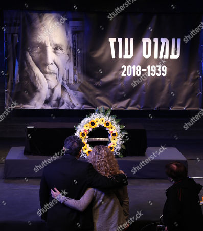 People stand in front of the coffin of Israeli author Amos Oz during a memorial service at the Tzavta Theater in Tel Aviv, Israel, 31 December 2018. Amos Oz, an award-winning Israeli writer, published 40 books in his career and his works have been translated into 45 different languages. Oz died at the age of 79 after suffering from cancer on 28 December 2018.