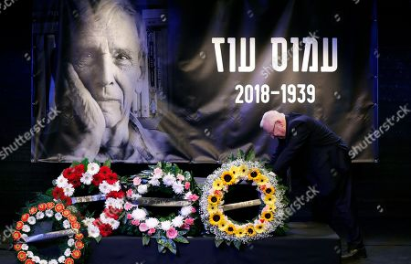 Stock Picture of Israeli President Reuven Rivlin lean on the coffin of Israeli author Amos Oz during a memorial service at the Tzavta Theater in Tel Aviv, Israel, 31 December 2018. Amos Oz, an award-winning Israeli writer, published 40 books in his career and his works have been translated into 45 different languages. Oz died at the age of 79 after suffering from cancer on 28 December 2018.