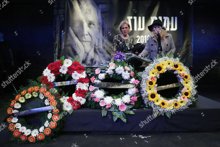 People lay flowers at the coffin of Israeli author Amos Oz during a memorial service at the Tzavta Theater in Tel Aviv, Israel, 31 December 2018. Amos Oz, an award-winning Israeli writer, published 40 books in his career and his works have been translated into 45 different languages. Oz died at the age of 79 after suffering from cancer on 28 December 2018.