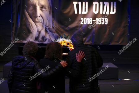 People show respect pass by the coffin of Amos Oz during his funeral service in Tel Aviv, Israel, . Israeli author Amos Oz, one of the country's most widely acclaimed writers and a pre-eminent voice in its embattled peace movement, died on Friday after a battle with cancer, his family announced. He was 79