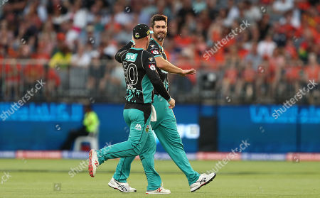 Ben Cutting of the Heat celebrates taking the wicket of Cameron Bancroft of the Scorchers with Chris Lynn