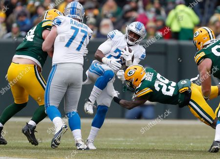 Detroit Lions' Theo Riddick runs during the first half of an NFL football game against the Green Bay Packers, in Green Bay, Wis. The Packers won 34-20