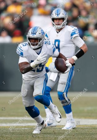 Detroit Lions' Theo Riddick runs during the first half of an NFL football game against the Green Bay Packers, in Green Bay, Wis