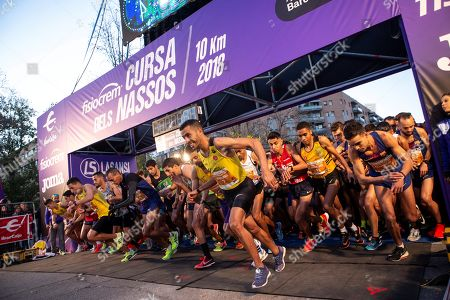 Several athletes start the New Year's Ever race called 'La Cursa dels Nassos' (The Race of Noses) in Barcelona, northeastern Spain, 31 December 2018.