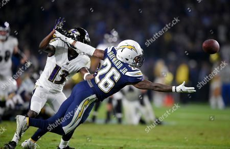 Casey Hayward, John Brown. Los Angeles Chargers cornerback Casey Hayward tries to intercept a pass intended for Baltimore Ravens wide receiver John Brown during the second half in an NFL football game, in Carson, Calif