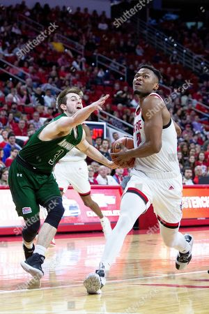 North Carolina State's Torin Dorn (2) drives past Loyola Maryland's Luke Johnson (3) during the second half of an NCAA college basketball game in Raleigh, N.C