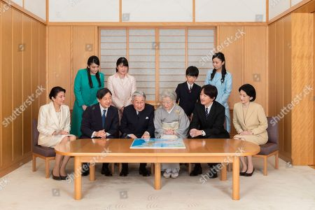 On and provided by the Imperial Household Agency of Japan on Jan. 1, 2019 shows Japanese Emperor Akihito, seated third from left, and Empress Michiko, seated fourth from left, looking a map with their family members during a family photo session for the New Year at the Imperial Palace in Tokyo. Imperial family members in this photo are, front left, to right, Crown Princess Masako, Crown Prince Naruhito, Emperor Akihito, Empress Michiko, Prince Akishino, and Princess Kiko, and, back from left to right, Princess Mako, Princess Aiko, Prince Hisahito, and Princess Kako