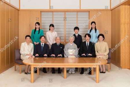 On and provided by the Imperial Household Agency of Japan on Jan. 1, 2019 shows Japanese Emperor Akihito, seated third from left, and Empress Michiko, seated fourth from left, pose with their family members during a family photo session for the New Year at the Imperial Palace in Tokyo. Imperial family members in this photo are, front left, to right, Crown Princess Masako, Crown Prince Naruhito, Emperor Akihito, Empress Michiko, Prince Akishino, and Princess Kiko, and, back from left to right, Princess Mako, Princess Aiko, Prince Hisahito, and Princess Kako
