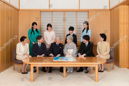 On and provided by the Imperial Household Agency of Japan on Jan. 1, 2019 shows Japanese Emperor Akihito, seated third from left, and Empress Michiko, seated fourth from left, with their family members during a family photo session for the New Year at the Imperial Palace in Tokyo. Imperial family members in this photo are, front left, to right, Crown Princess Masako, Crown Prince Naruhito, Emperor Akihito, Empress Michiko, Prince Akishino, and Princess Kiko, and, back from left to right, Princess Mako, Princess Aiko, Prince Hisahito, and Princess Kako