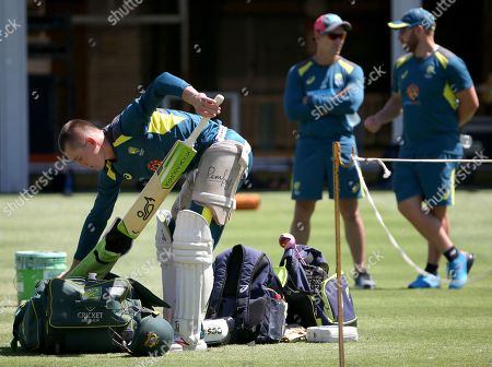 Marnus Labuschagne, Justin Langer, Aaron Finch. Australia's Marnus Labuschagne, left, prepares to bat as head coach Justin Langer and batsman Aaron Finch, right, chat, during an optional training session in the nets in Sydney, ahead of their cricket test match against India starting Jan. 3