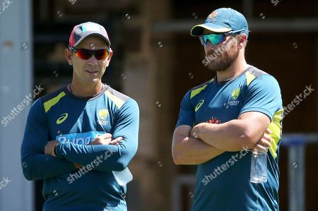 Justin Langer, Aaron Finch. Australia's head cricket coach Justin Langer, left, chats with batsman Aaron Finch during an optional training session in the nets in Sydney, ahead of their test match against India starting Jan. 3