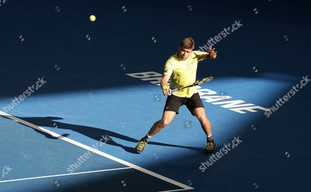 Ryan Harrison of the United States plays a shot during his match against Nick Kyrgios of Australia at the Brisbane International tennis tournament in Brisbane, Australia