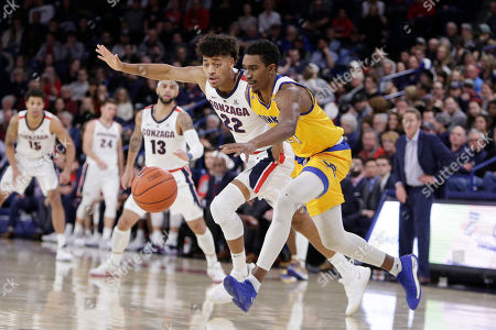 Gonzaga forward Jeremy Jones (22) and Cal State Bakersfield forward Greg Lee go after the ball during the first half of an NCAA college basketball game in Spokane, Wash