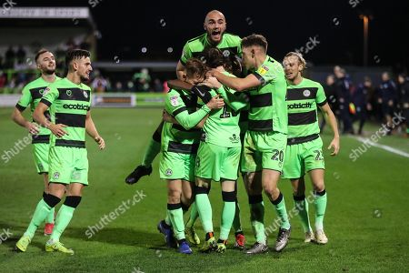 Forest Green Rovers Theo Archibald(18) scores a goal 2-1 and celebrates with his team mates during the EFL Sky Bet League 2 match between Forest Green Rovers and Northampton Town at the New Lawn, Forest Green