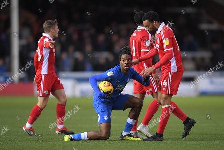 James Perch of Scunthorpe United argues with Ivan Toney of Peterborough United
