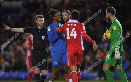 Ivan Toney of Peterborough United argues with James Perch of Scunthorpe United and Scunthorpe United Goalkeeper Jak Alnwick