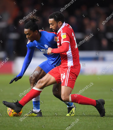 Ivan Toney of Peterborough United and James Perch of Scunthorpe United
