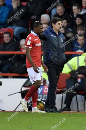 Aitor Karanka manager of Nottingham Forest pats Tendayi Darikwa of Nottingham Forest on the head.