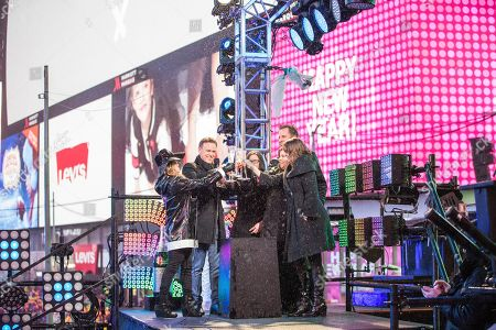 Allison Hagendorf, Swarovski Crystal. People toast on stage at the New Year's Eve celebration in Times Square, in New York
