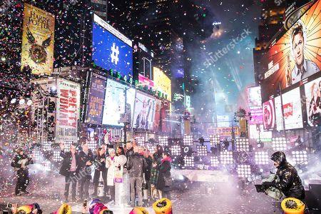 Stock Photo of Journalists including Joel Simon, Karen Toulon, Matt Murray, Rebecca Blumenstein, Jon Scott, Alisyn Camerota Lester Holt, Martha Raddatz, Karen Attiah, Vladimir Duthiers, Edward Felsenthal, and Maria Ressa appear on stage during at the New Year's celebration in Times Square, in New York