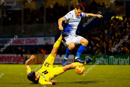 Tom Lockyer of Bristol Rovers is tackled by Ben Fox of Burton Albion