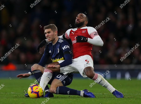 Stock Image of Alexandre Lacazette of Arsenal and Maxime Le Marchand of Fulham