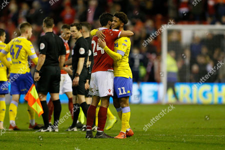 Nottingham Forest defender Caludio Jacob and Leeds United forward Tyler Roberts (11) embrace at full time during the EFL Sky Bet Championship match between Nottingham Forest and Leeds United at the City Ground, Nottingham