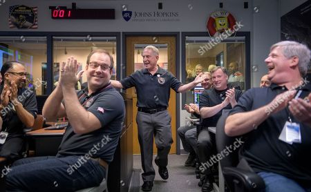 New Horizons principal investigator Alan Stern, center, of the Southwest Research Institute in Boulder, Colo., celebrates with other mission team members after they received signals from the New Horizons spacecraft that it is healthy and collected data during the flyby of Ultima Thule, at the Mission Operations Center at the APL in Laurel, Md