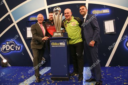 Barry Hearn with Michael Smith and Michael van Gerwen with the trophy during the 2019 William Hill World Darts Championship Final at Alexandra Palace, London