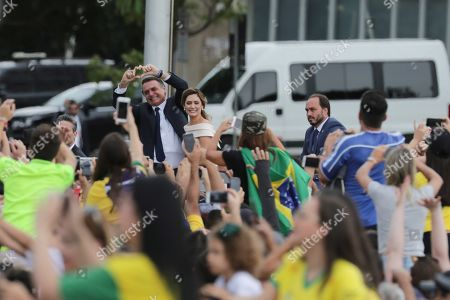 Brazilian President-elect Jair Bolsonaro (C-L) and wife Michele (C-R) head to the Planalto Palace for a ceremony in which Bolsonaro will receive the presidential band from his predecessor, Michel Temer, in Brasilia, Brazil, 01 January 2019. A far-right president leads the biggest Latin America democracy for first time since the end of military rule (1964-1985). Bolsonaro defeated candidate Fernando Haddad in the runoff, held last October, receiving 55 percent of the vote.
