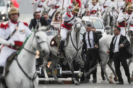 Brazilian President-elect Jair Bolsonaro (2-L) and wife Michele (C-back) head to the Planalto Palace on a Rolls Royce, for a ceremony in which Bolsonaro will receive the presidential band from his predecessor, Michel Temer, in Brasilia, Brazil, 01 January 2019. A far-right president leads the biggest Latin America democracy for first time since the end of military rule (1964-1985). Bolsonaro defeated candidate Fernando Haddad in the runoff, held last October, receiving 55 percent of the vote.