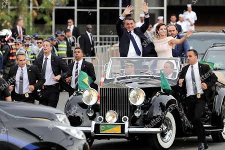 Brazilian President-elect Jair Bolsonaro (4-R) and wife Michele (3-R) head to the Planalto Palace on a Rolls Royce, for a ceremony in which Bolsonaro will receive the presidential band from his predecessor, Michel Temer, in Brasilia, Brazil, 01 January 2019. A far-right president leads the biggest Latin America democracy for first time since the end of military rule (1964-1985). Bolsonaro defeated candidate Fernando Haddad in the runoff, held last October, receiving 55 percent of the vote.