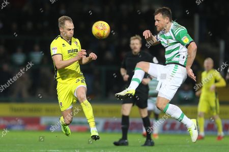 Luke Varney and Gary Warren  during the EFL Sky Bet League 2 match between Yeovil Town and Cheltenham Town at Huish Park, Yeovil