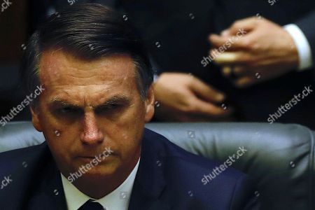 Brazilian President-elect Jair Bolsonaro reacts during his inauguration ceremony in which he received the presidential band from his predecessor, Michel Temer, at the Congress in Brasilia, Brazil, 01 January 2019. A far-right president leads the biggest Latin America democracy for first time since the end of military rule (1964-1985). Bolsonaro defeated candidate Fernando Haddad in the runoff, held last October, receiving 55 percent of the vote.